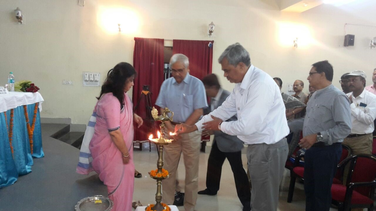 Prof. Harekrishna Misra (middle) lighting the lamp during the opening ceremony